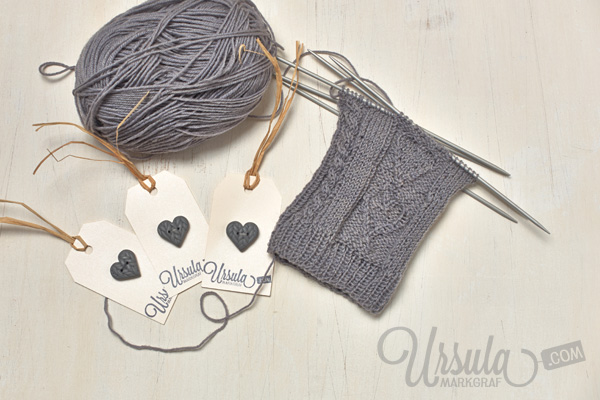 Knitted legwarmers and handmade button by Ursula Markgraf